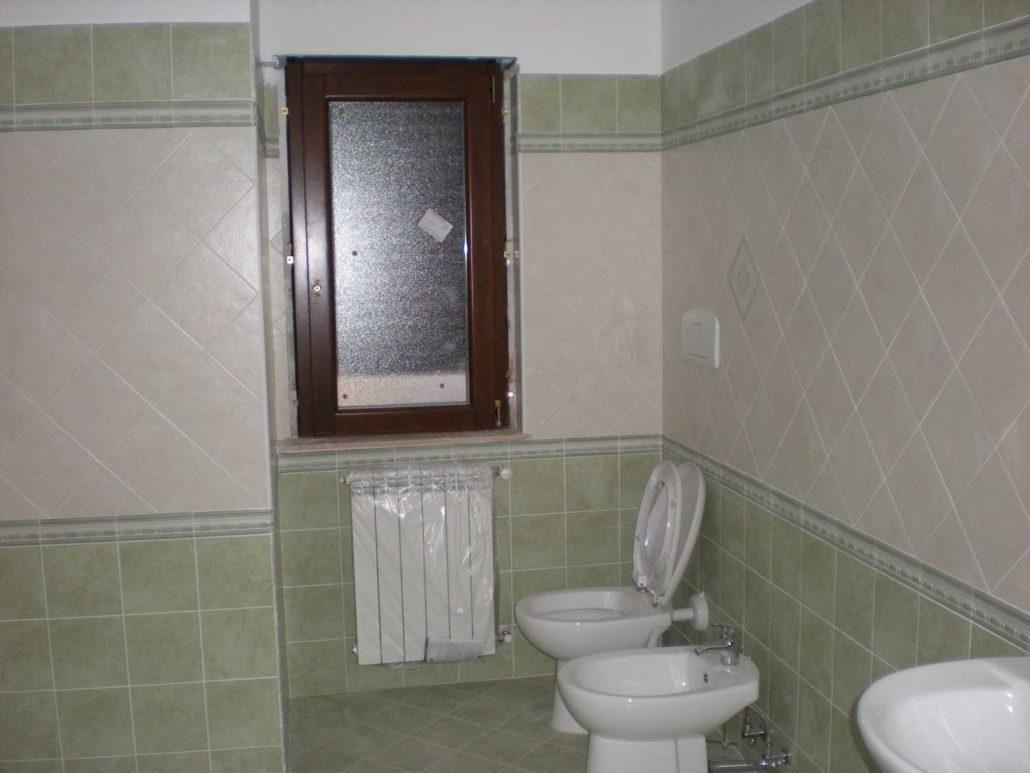 Ristrutturazioni edilizie in calabria coan costruzioni - Rifacimento bagno manutenzione ordinaria ...
